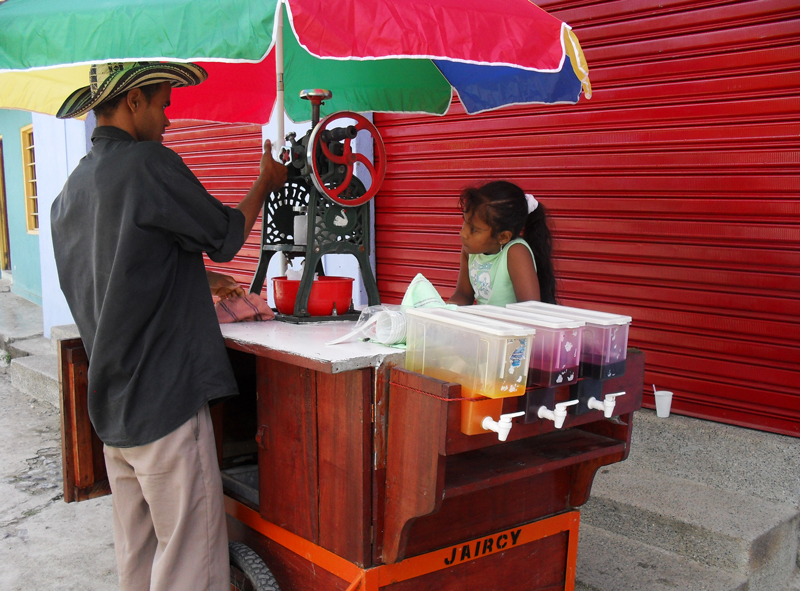 Man selling a slush ice to a girl